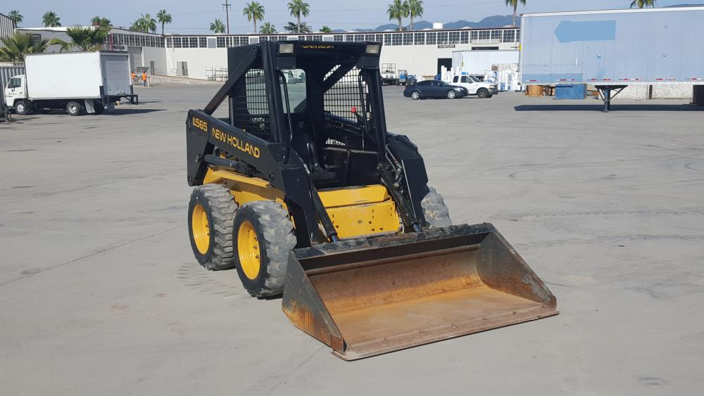 NEW HOLLAND LX565 SKIDSTEER LOADER, gp bucket, aux